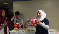 Om Al-Qura volunteer leading a Community Fundraise Auction