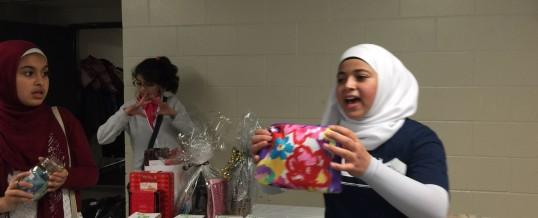 Om Al-Qura volunteer leading a Community Fundraise Auction